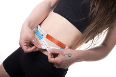 Woman measuring her waist. Royalty Free Stock Photos