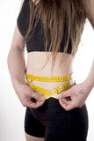 Woman measuring her waist. Royalty Free Stock Images