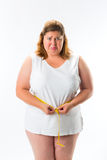 Woman measuring her waist with tape Royalty Free Stock Photography