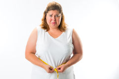 Woman measuring her waist with tape Royalty Free Stock Photos
