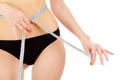 Woman measuring her waistline Royalty Free Stock Photos