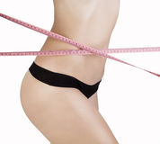 Woman measuring her waistline Royalty Free Stock Image