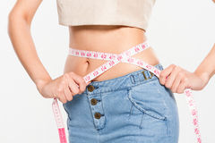 Woman measuring her waistline Stock Photos