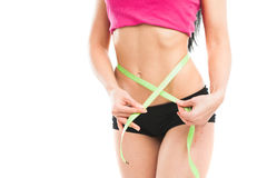 Woman measuring her waistline Stock Images