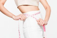 Close Up Woman measuring her waistline with measure line Royalty Free Stock Photos