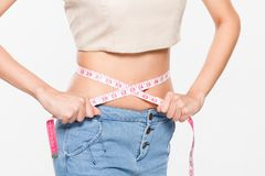 Close Up Woman measuring her waistline with measure line Royalty Free Stock Photography