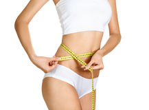 Woman measuring her waistline. Perfect Slim Body Royalty Free Stock Photo