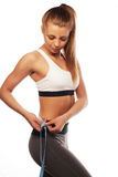 Woman measuring her waistline . Perfect Slim Body Royalty Free Stock Images