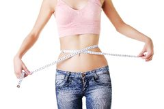 Woman measuring her waistline Royalty Free Stock Images