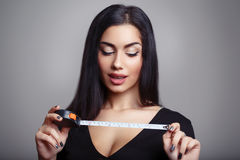 Woman Measuring Penis Stock Photography