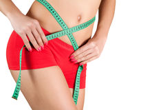 Woman measuring perfect shape of beautiful hips. Stock Images