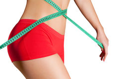 Woman measuring perfect shape of beautiful hips. Stock Photography