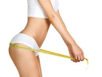 Woman measuring perfect shape of beautiful hips Royalty Free Stock Photography