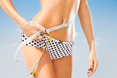 Woman measuring perfect shape of beautiful hips. Stock Photos
