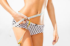 Woman measuring perfect shape of beautiful hips. Royalty Free Stock Images