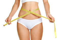 Woman measuring perfect shape of beautiful thigh Royalty Free Stock Image