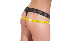 Woman measuring perfect shape of beautiful thigh healthy. Royalty Free Stock Photos
