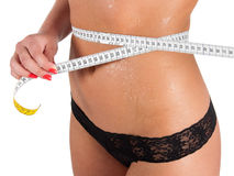 Woman measuring perfect shape of beautiful thigh healthy. Stock Image