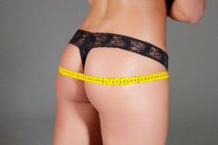 Woman measuring perfect shape of beautiful thigh healthy. Stock Photos