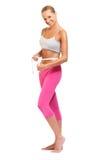 Woman measuring perfect shape of beautiful waist Stock Photo
