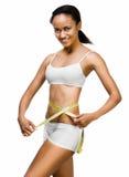 Woman measuring perfect shape of beautiful waist Royalty Free Stock Photos