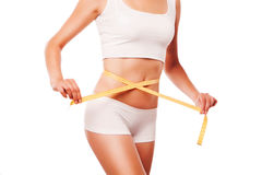 Woman measuring perfect shape. Healthy lifestyles Royalty Free Stock Images