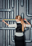 Woman measuring pipe length Stock Image