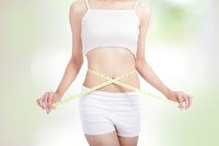 Woman measuring shape of beautiful waist Royalty Free Stock Photos