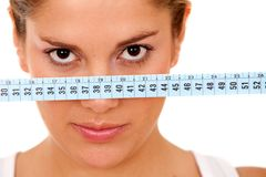 Woman with a measuring tape Stock Photography