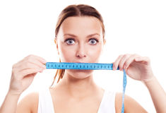 Woman with measuring tape Royalty Free Stock Images