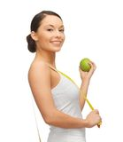 Woman with measuring tape and apple Stock Image