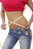 Woman with measuring tape around her belly Royalty Free Stock Photo