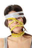Woman with measuring tape around her head Stock Image