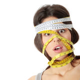 Woman with measuring tape around her head Stock Photos
