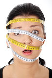 Woman with measuring tape around her head Royalty Free Stock Photo