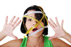 Woman with measuring tape around her head Stock Photo