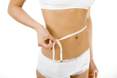 Slim woman measuring her waist Stock Photo
