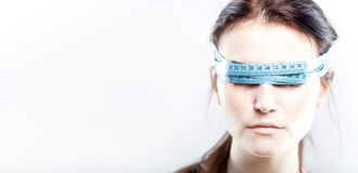 Woman with measuring tape on eyes Stock Photos