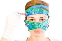 Woman with a measuring tape on head. Royalty Free Stock Photos