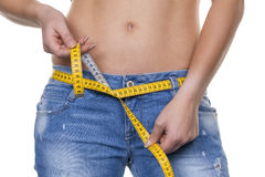 Woman with measuring tape before the next diet Royalty Free Stock Photo