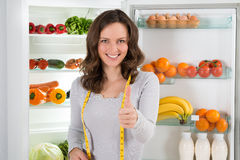 Woman With Measuring Tape Showing Thumbs Up Sign Royalty Free Stock Photos