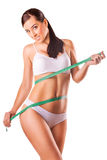 Woman with measuring tape on a white Stock Photos