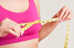 Woman Measuring Up Her Chest Royalty Free Stock Image