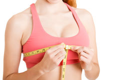 Woman Measuring Up Her Chest Stock Photography