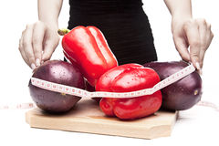 Woman measuring vegetables Stock Photo