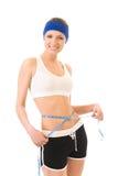 Woman measuring waist Stock Image