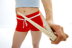 Woman measuring waist Stock Photo
