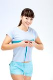 Woman measuring waist Royalty Free Stock Photography