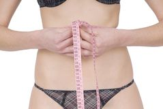 Woman measuring waist Royalty Free Stock Images