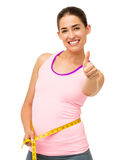 Woman Measuring Waist While Gesturing Thumbs Up Royalty Free Stock Photo